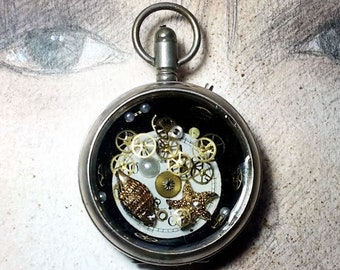 Handmade unisex Steampunk pendant, pocketwatch case, dial, cogs, resin , metal shells, for men and women , black leather cord