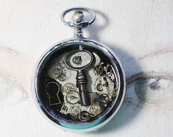 Unisex Steampunk pendant, pocketwatch case, dial, cogs, resin, an old key , freshwater pearl, for men and women , black leather cord