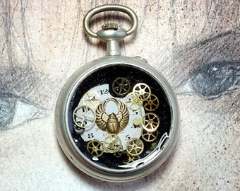 Handmade unisex Steampunk pendant, pocketwatchcase, gold colour egyptian beetle, dial, cogs, resin , for men and women , leather strap