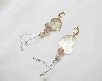 Handmade earrings with bronze hearts and light pink glass beads