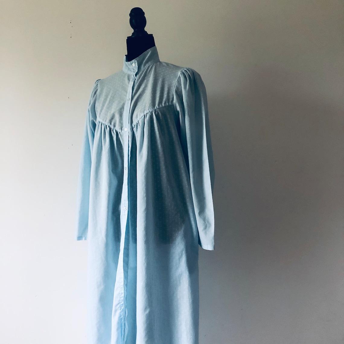 Leg o mutton sleeve blue see through button front robe dress