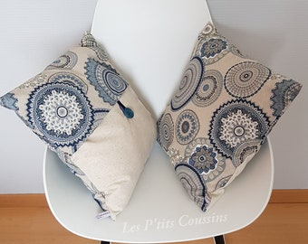 Cushion cover with boho patterns of mandalas with shades of blue on linen-colored background