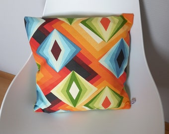 Cushion cover or fabric pan with multicolored vintage psychedelic patterns
