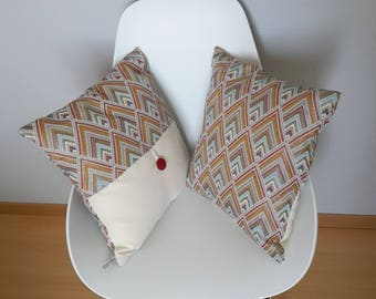 Pillow cover in multicolored geometric patterns in a thick fabric with the satin