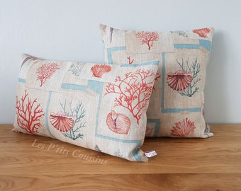 Cushion cover with marine patterns of corals and shells for a seaside decoration