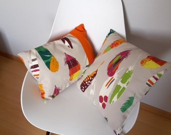 Pillow cover multicolored feathers on a background color taupe for a bedroom