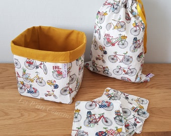 Box including a pan, a tote bag and washable wipes with colorful bicycle patterns
