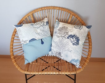 Cushion cover with marine patterns of shell fish and corals in shades of blue