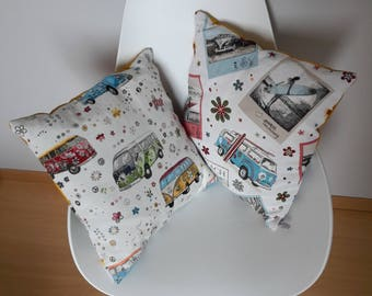 Cushion cover with vintage patterns of multicolored volkswagen combi on a light gray background