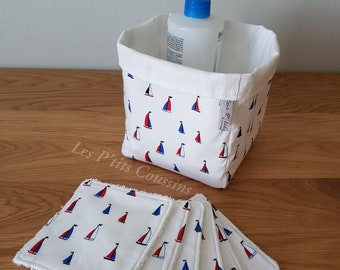 Washable wipe and pan with sailboat patterns in red and blue on a white background