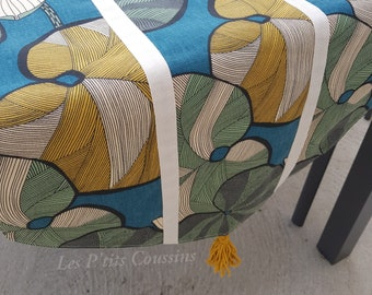 Table runner with tropical patterns of flowers and foliage