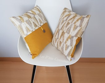 Cushion cover with geometric patterns in mustard yellow and light grey