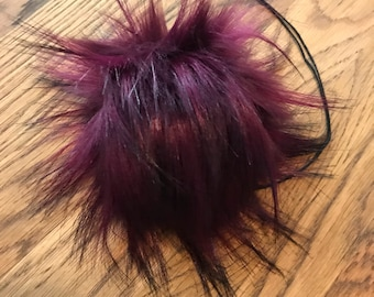 Boysenberry bomb faux fur pom pom.