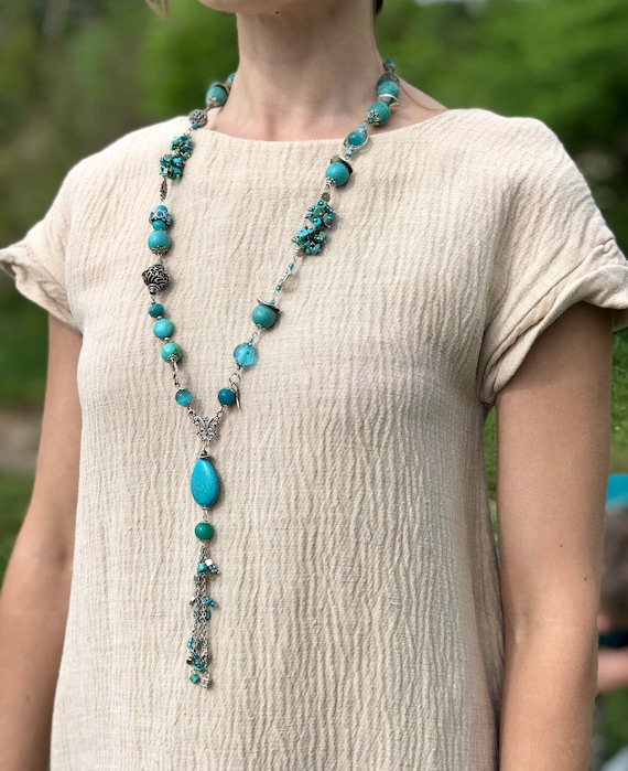 Long pendant blue necklace Boho pendant necklace with turquoise beads Art necklace with a blue semiprecious stone and black lether cords
