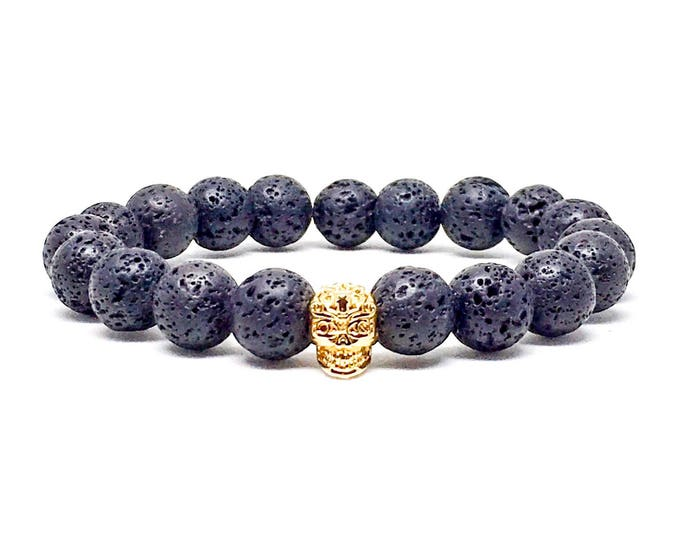 Men's bracelet with Lava stone and gold skull.
