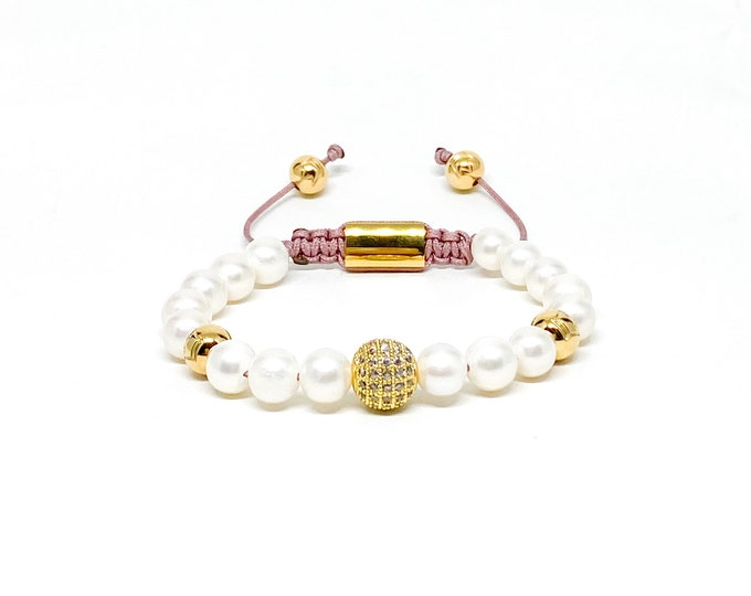 Women's bracelet with AAA natural white freshwater Pearls, cubic zirconia and gold over stainless steel crown logo beads