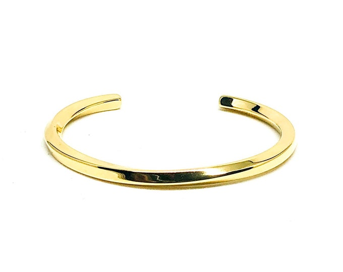 Men's cuff 18k gold plated over stainless steel.