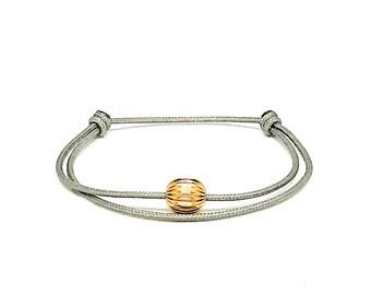 Women's 14k gold filled gray cord bracelet.