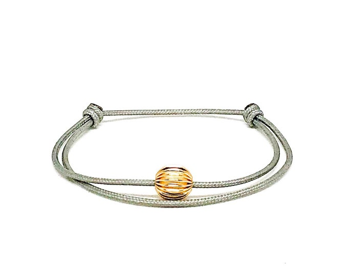 Women's 14k gold filled gray cord bracelet.