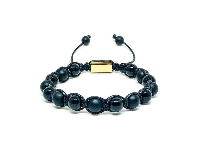 Men's bracelet with Onyx and 18k gold over 316L stainless steel signature Gregorio New York logo.