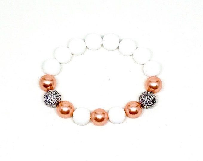 Women's bracelet made with Rose Peach Swarovski Crystal Pearls, White Onyx and CZ Diamonds.