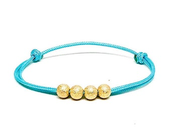 Women's gold filled stardust light blue  cord bracelet