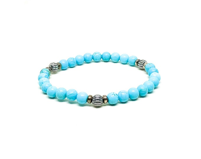 Men's bracelet with Turquoise and sterling silver spacers.