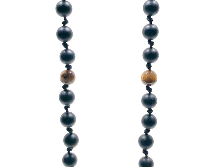 Men's necklace with Matte Onyx and Tiger Eye. Very slick and modern knotted design for those who dare.
