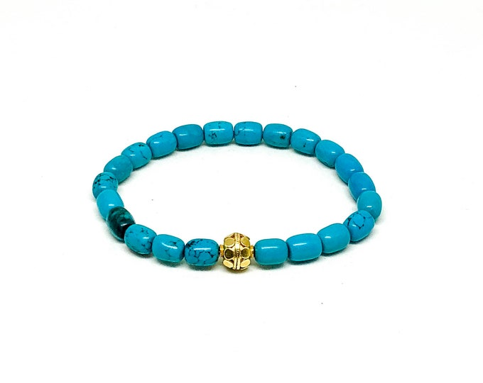 Men's bracelet with Turquoise barrel shaped and Vermeil bead.