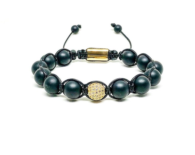 Men's bracelet with Matte Onyx, Cubic Zirconia and 18k gold over 316L stainless steel signature Gregorio New York logo.