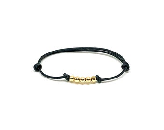 Cord bracelet with black nylon cord and 14k gold filled for men and women.