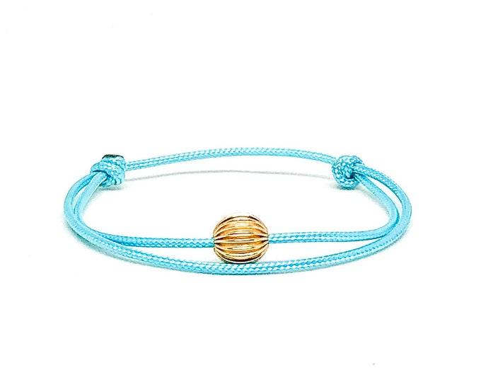 Women's 14k gold filled blue cord bracelet.