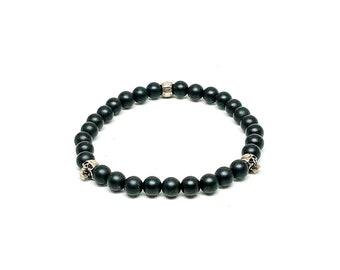 Men's bracelet with Matte Onyx and 925 Silver skulls.
