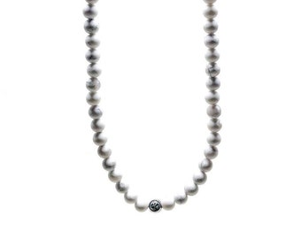 Men's Necklace made with OM 925 Silver beads and Howlite.