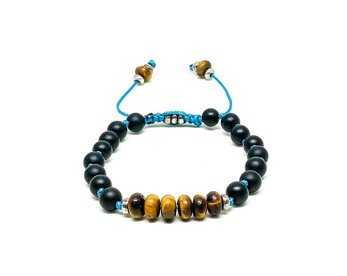 Blue knotted cord with Tiger Eye, Onyx and sterling silver spacers.