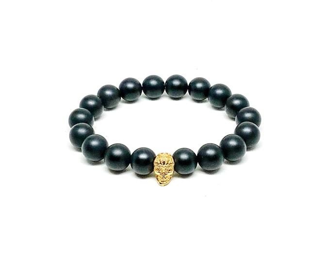 Men's bracelet with Matte Onyx and gold skull.