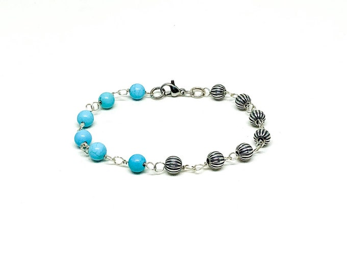 Men's bracelet with turquoise and 925 silver beads.