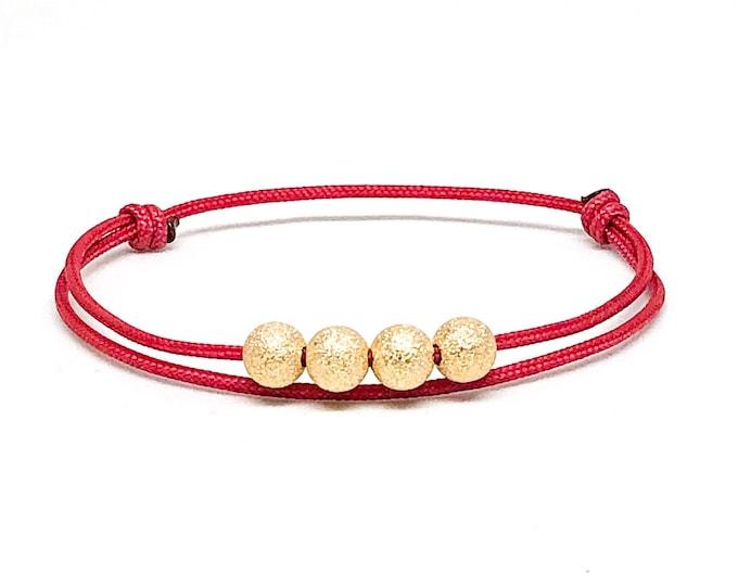 Women's gold filled stardust red cord bracelet.