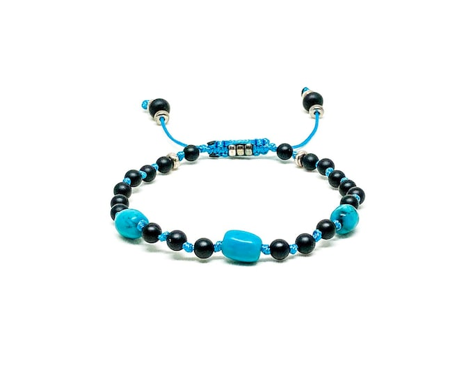 Knotted beaded bracelet with Onyx, Turquoise and sterling silver spacers.