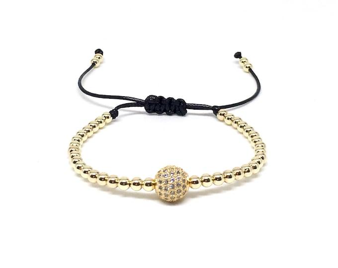 Men's bracelet with 14k gold filled beads and CZ diamonds.