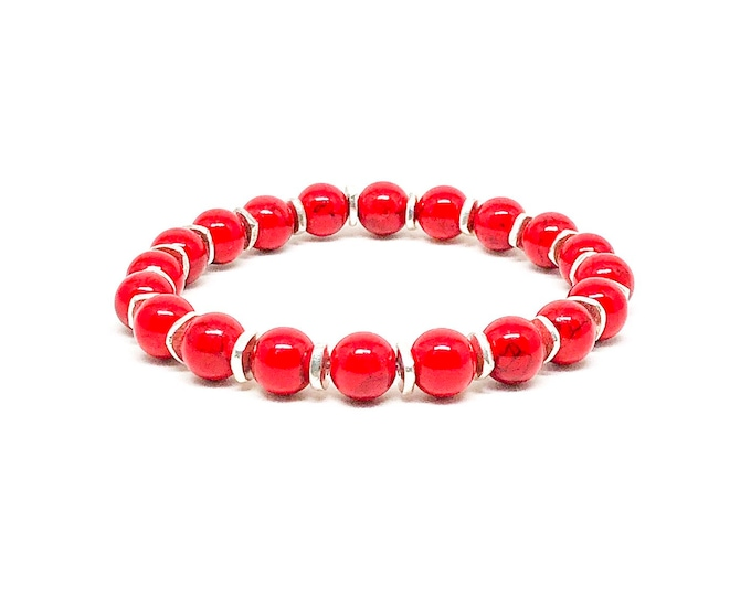 Men's bracelet with red Jade and silver spacers.