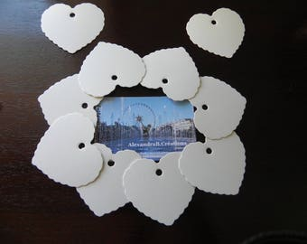 10 tags white cardboard hearts that measure 5.5 x 5.8 CM