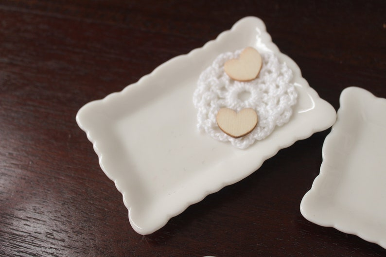 1 mini pillow in beige porceleine decorated heart wood on a white cotton doily