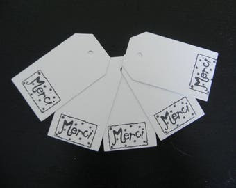 "5 large tags white cardstock with the inscription ""Merci"""