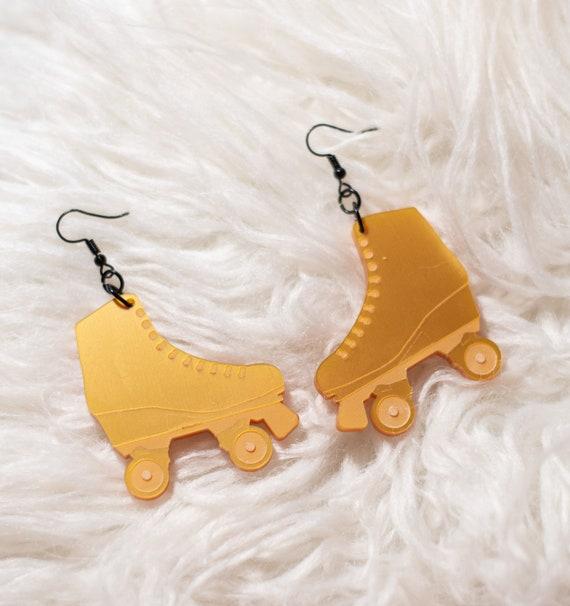 Skate gold statement earrings