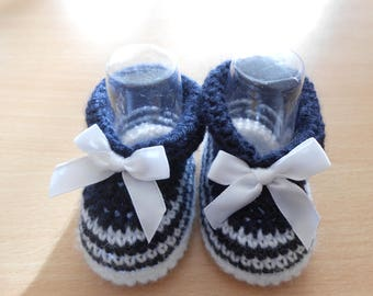 Navy blue baby booties and white