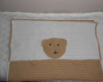White and beige baby blanket