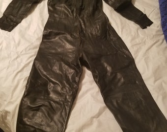 505509f5cee7 Black leather vintage bespoke catsuit ala cat woman Apollonia