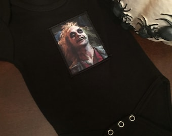 Black cotton baby onesie with adorable Beetlejuice patch!