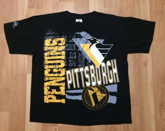 62de1529f Large 90 s Pittsburgh Penguins men s vintage T shirt black yellow 1990 s  Apex One NHL Hockey Pennsylvania L
